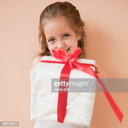 Young girl holding out present : Stock Photo