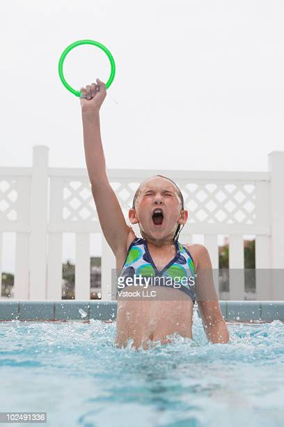 Young girl holding pool ring