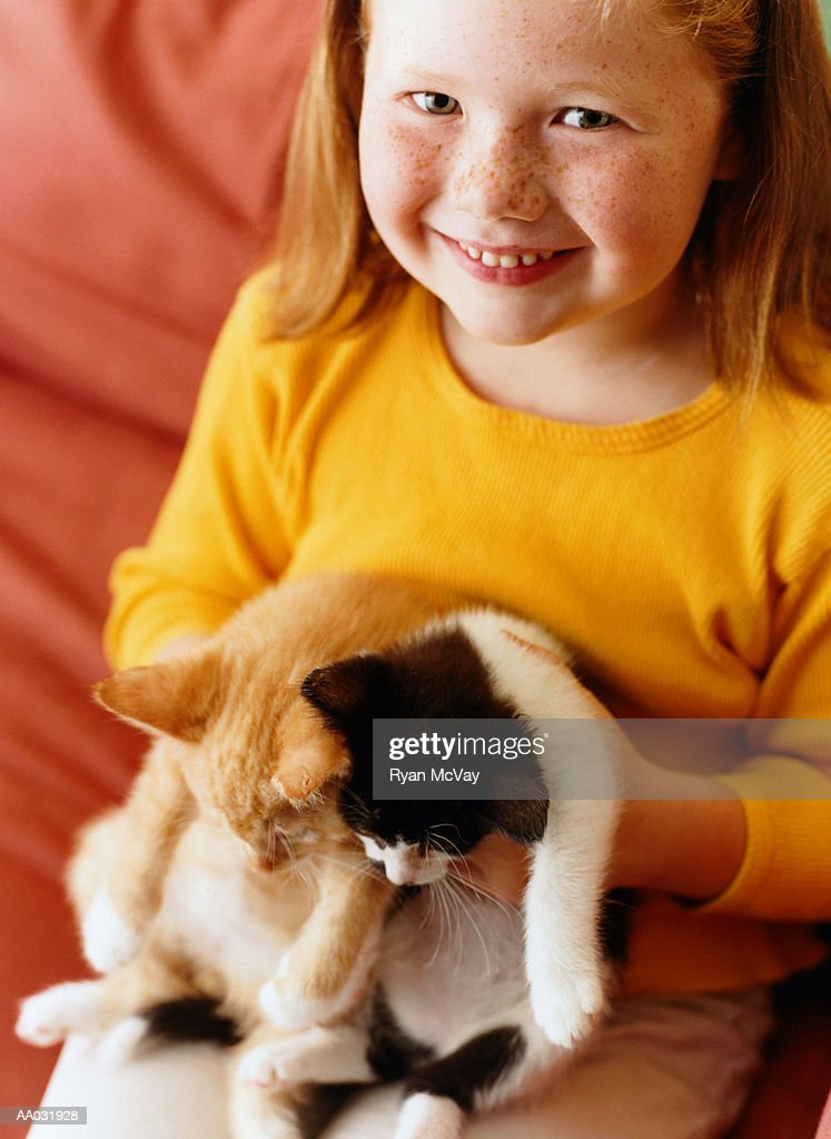 Young Girl Holding Two Kittens : Stock Photo
