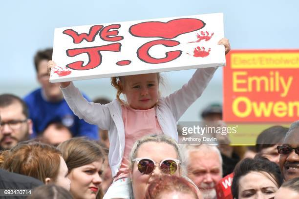 A young girl holds a sign as Labour party leader Jeremy Corbyn speaks to supporters on the Promenade on June 7 2017 in Colwyn Bay Denbighshire United...