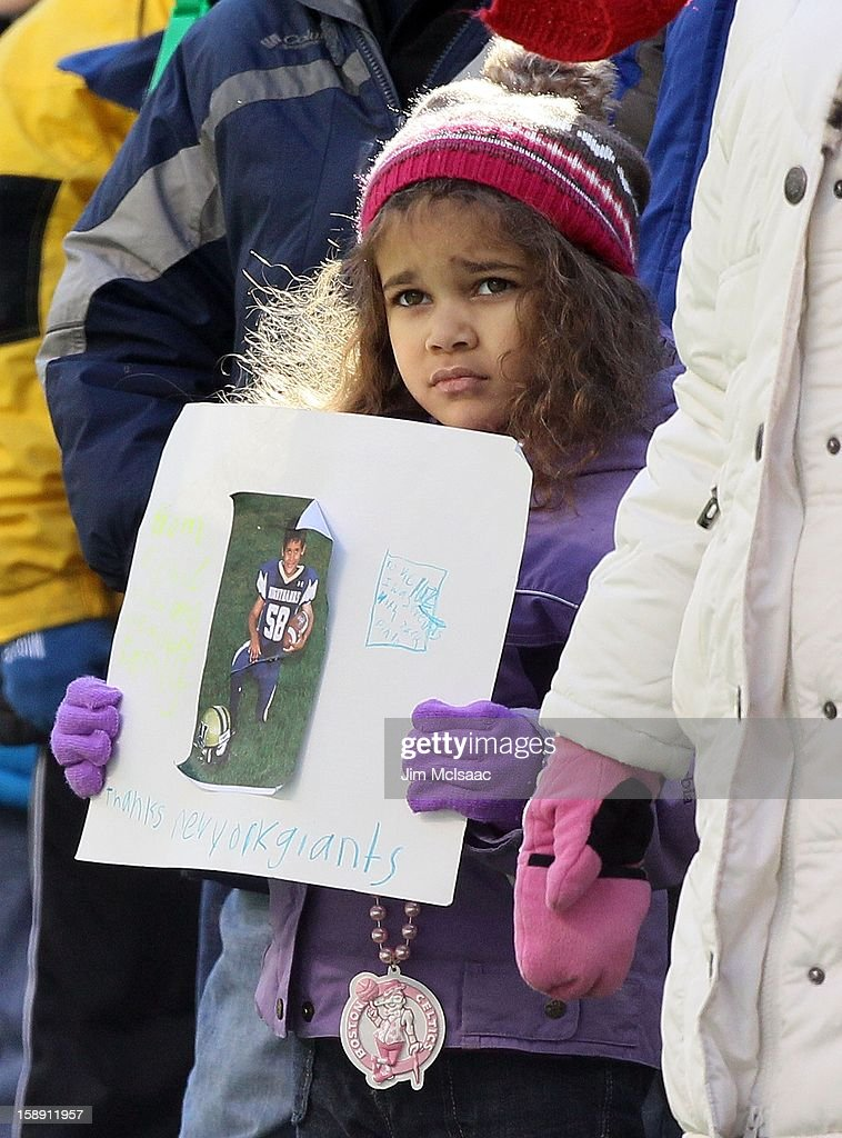 A young girl holds a sign that reads 'to Victor Cruz I was friends with Jack Pinto' and 'thanks New York Giants' as students, parents and faculty of Sandy Hook Elementary School as well as residents of Newtown, Connecticut as they attend the NFL game between the New York Giants and the Philadelphia Eagles at MetLife Stadium on December 30, 2012 in East Rutherford, New Jersey. Jack Pinto was a victim of the school shooting and was a big fan of the Giants Victor Cruz.The Giants defeated the Eagles 42-7.