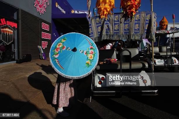 A young girl holds a umbrella from Myanmar during the Tamworth Country Music Festival Cavalcade on January 28 2017 in Tamworth Australia Tamworth is...