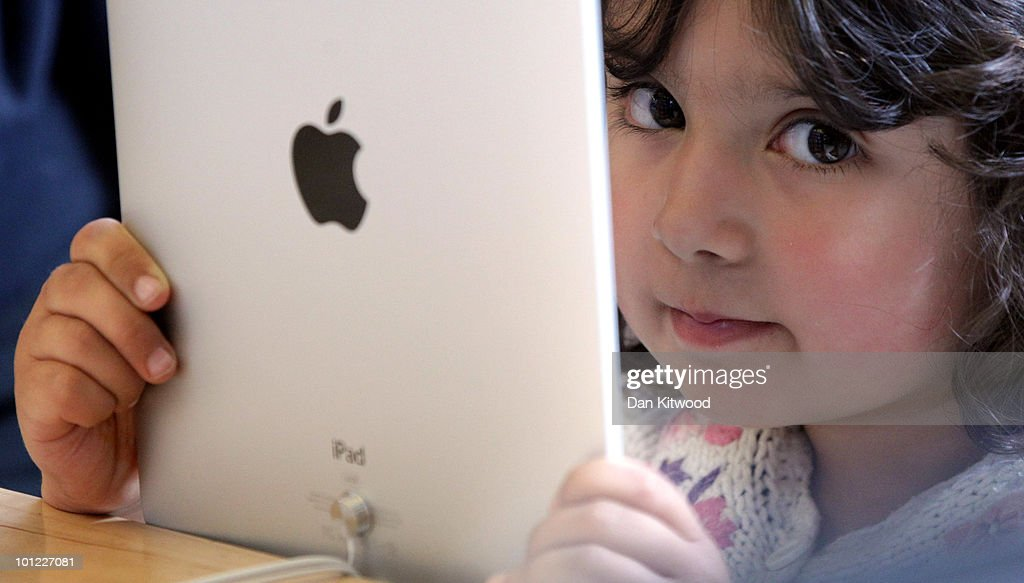 A young girl holds an Apple iPad on display at Regent Street's Apple store on May 28, 2010 in London, England. Apple iPads went on sale today in countries including Japan, Australia, Germany, Italy, Canada, Switzerland and the United Kingdom as part of Apple's global roll-out of the hugely successful new device.