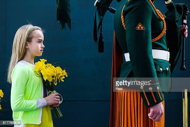 A young girl holds flowers during the Easter Sunday Commemoration Ceremony at the General Post Office on March 27 2016 in Dublin Ireland Today marks...