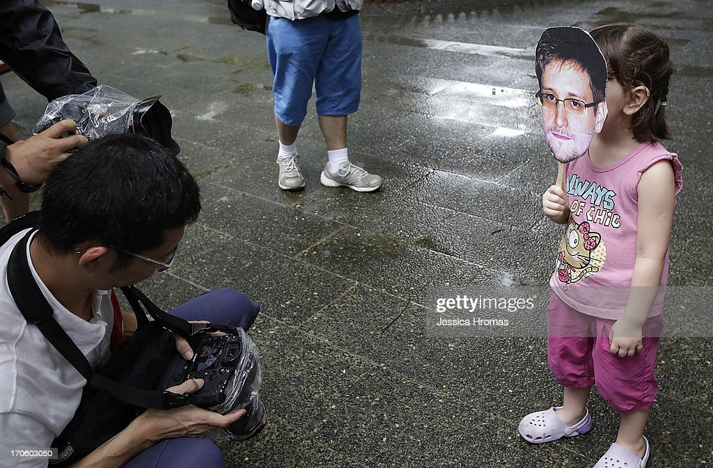 A young girl holds up a cut out image of <a gi-track='captionPersonalityLinkClicked' href=/galleries/search?phrase=Edward+Snowden&family=editorial&specificpeople=10983676 ng-click='$event.stopPropagation()'>Edward Snowden</a>s face at the start of the protest rally to support <a gi-track='captionPersonalityLinkClicked' href=/galleries/search?phrase=Edward+Snowden&family=editorial&specificpeople=10983676 ng-click='$event.stopPropagation()'>Edward Snowden</a> in on June 15, 2013 in Hong Kong, Hong Kong. Former CIA employee <a gi-track='captionPersonalityLinkClicked' href=/galleries/search?phrase=Edward+Snowden&family=editorial&specificpeople=10983676 ng-click='$event.stopPropagation()'>Edward Snowden</a> is accused of leaking details of top-secret US surveillance of phones and internet.