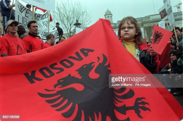 A young girl holds up a Kosovan flag as hundreds of Albanians gather Trafalgar Square London to show their support for NATO's air strikes against...