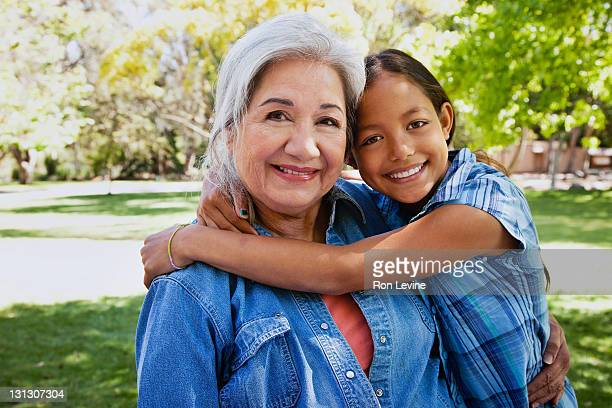 Young girl hugging grandmother, portrait