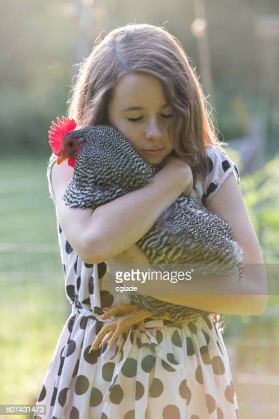 Young Girl hugging Rooster