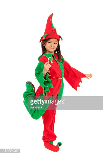 Young girl in a Christmas elf costume