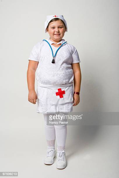 Young girl in a nurse Halloween costume