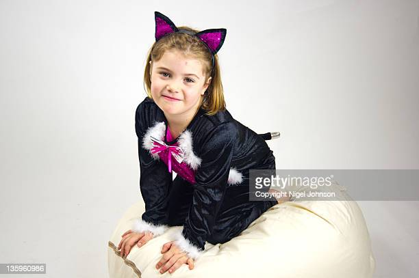 Young girl in cat suit