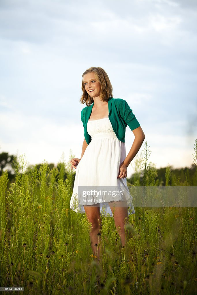 Young girl in field : Stock Photo