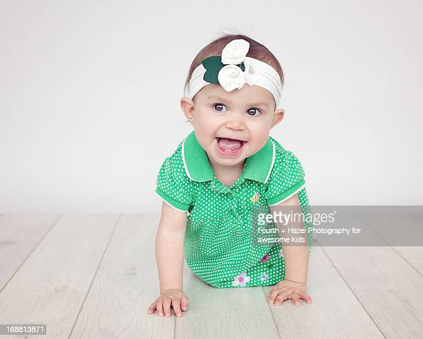 young girl in green dress