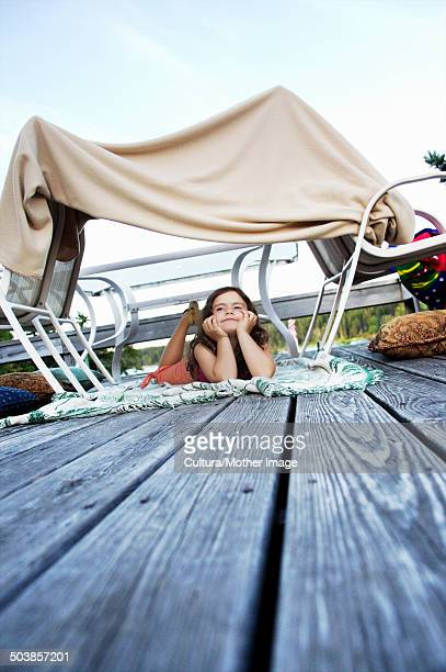 Young girl in homemade fort