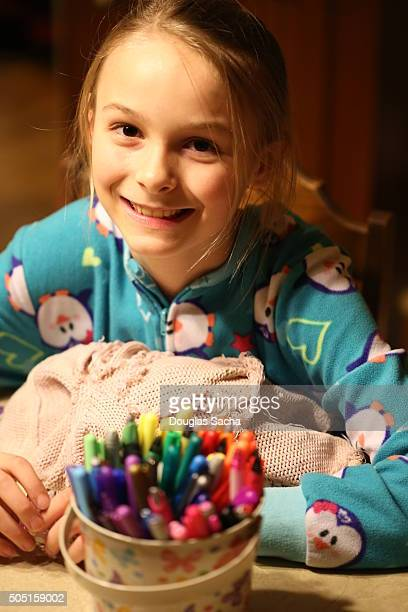 Young Girl in pajamas with security blanket