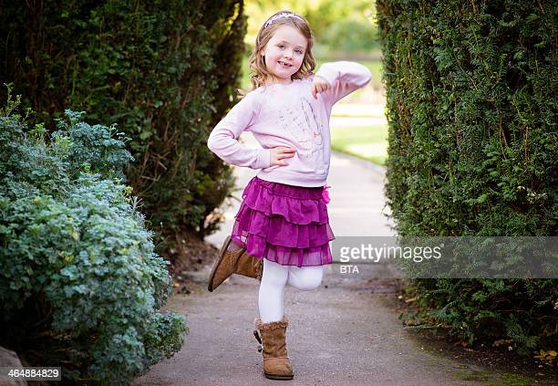 Young girl in pink skirt