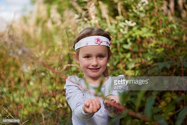 Young girl in rural setting, exploring