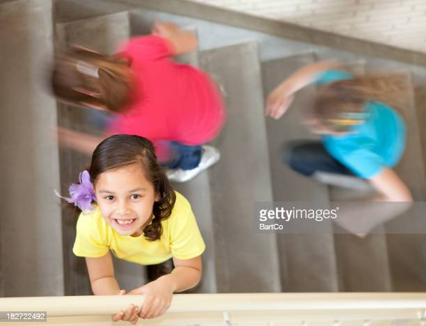 Young girl in staircase