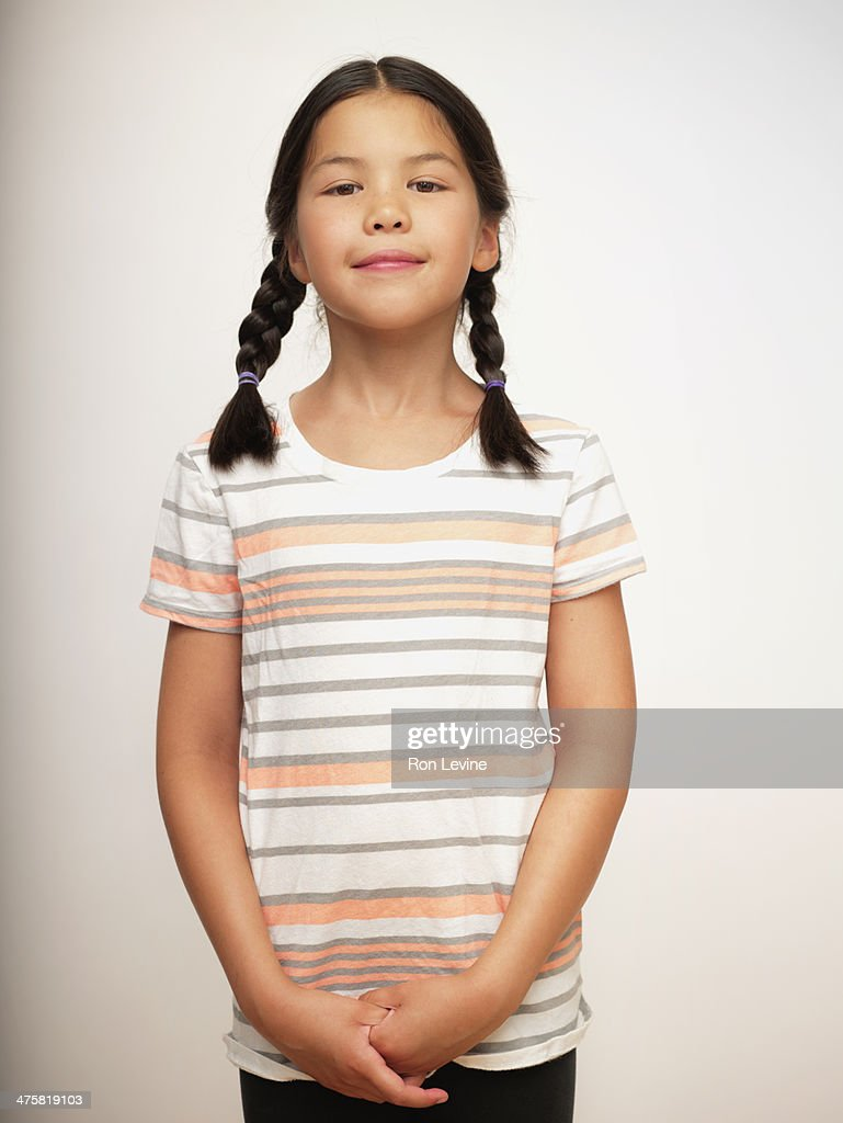 Young girl in striped shirt and braids, portrait