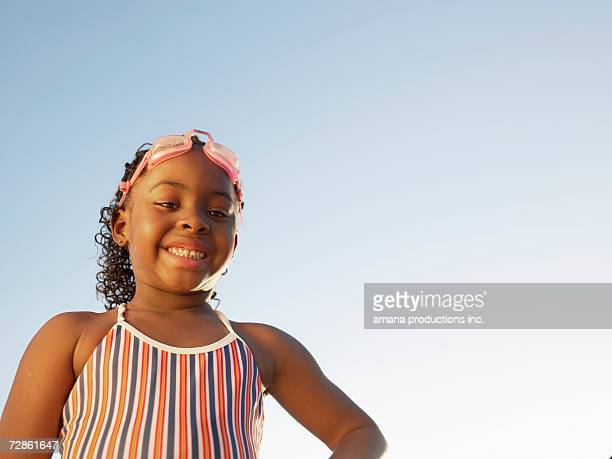Young girl in swimming costume (portrait, low angle view)