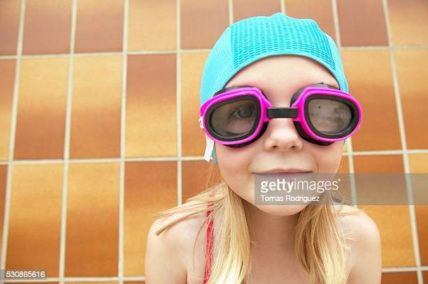 Young girl in swimming goggles