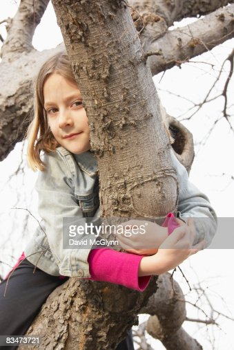 Young girl (9 years) in tree