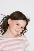 Young girl indoors looking at camera
