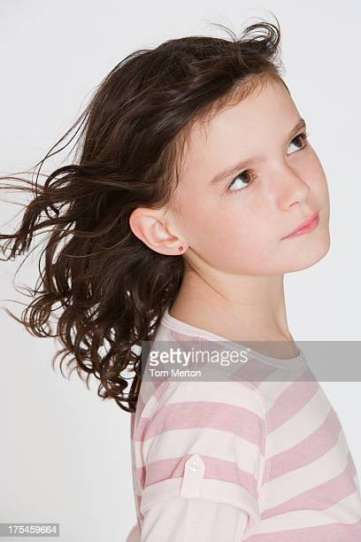 Young girl indoors looking outside