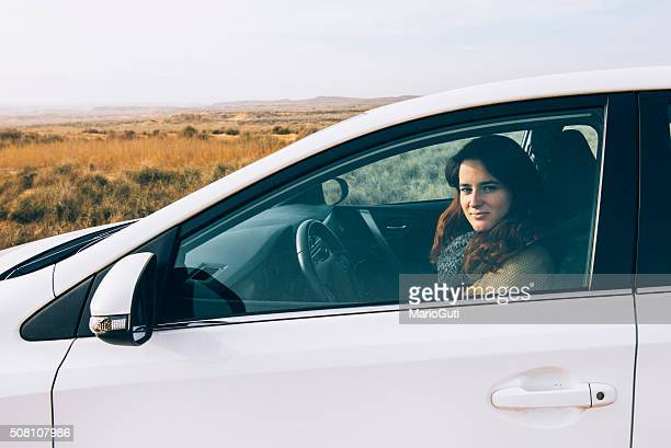 Young girl inside a car