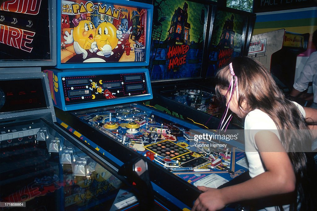 A young girl is photographed June 1 1982 playing PacMan at a video arcade in Times Square New York City