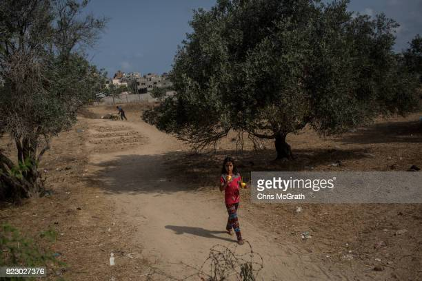 A young girl is seen in the AlBureji neighborhood on July 20 2017 in Gaza City Gaza For the past ten years Gaza residents have lived with constant...