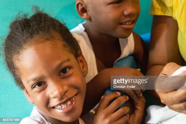 Santa Domingo Dominican Republic November 30 2012 A young girl is smiling towards the camera in the poor neighbourhood 'Los Alcarrizos' in Santa...