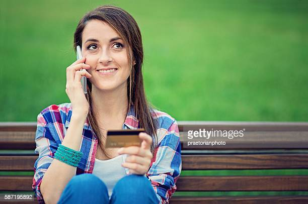 Young girl is talking using her mobile phone