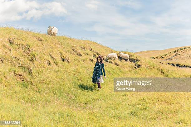 A young girl is walking in the countryside