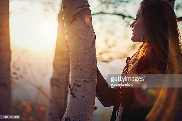 Young girl is watching the sunset in mountain