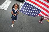 A young girl joins demonstrators marchoing from the location where Michael Brown was shot and killed to Normandy High School where he was a student...