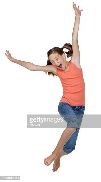 Young girl jumping for joy on white background