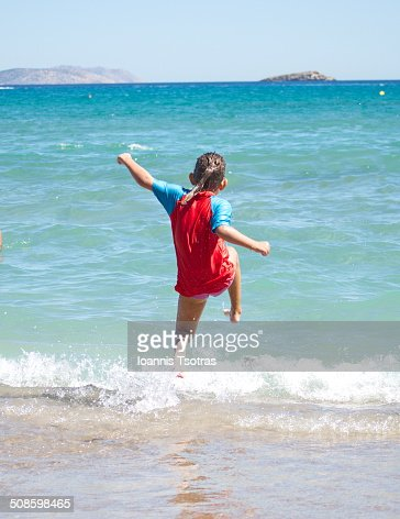 Young girl jumping in the water : Stock Photo