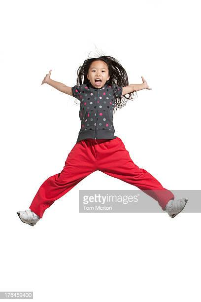 Young girl jumping indoors