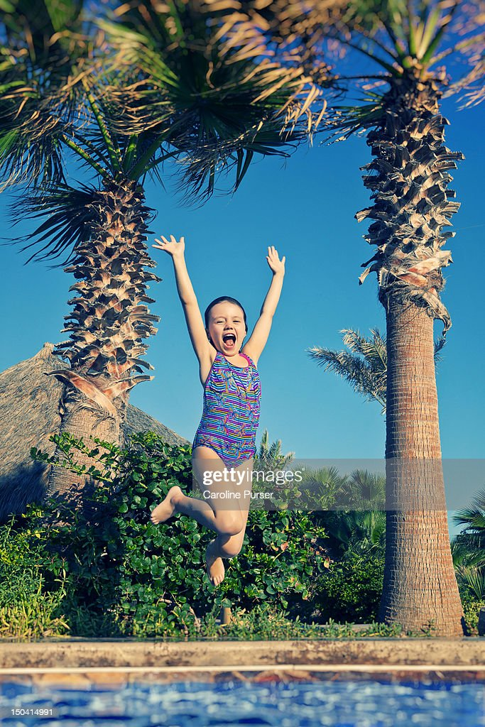 Young Girl Jumping Into A Swimming Pool Stock Photo Getty Images