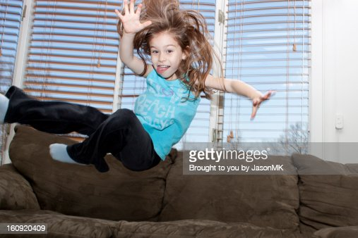Young Girl Jumping On The Couch Stock Photo Getty Images