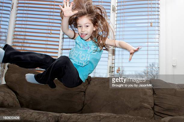 Young Girl Jumping on the Couch