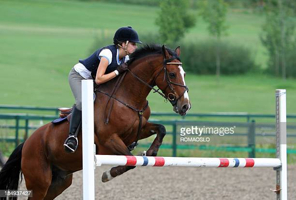young girl jumping with her irish sport pony, Norway