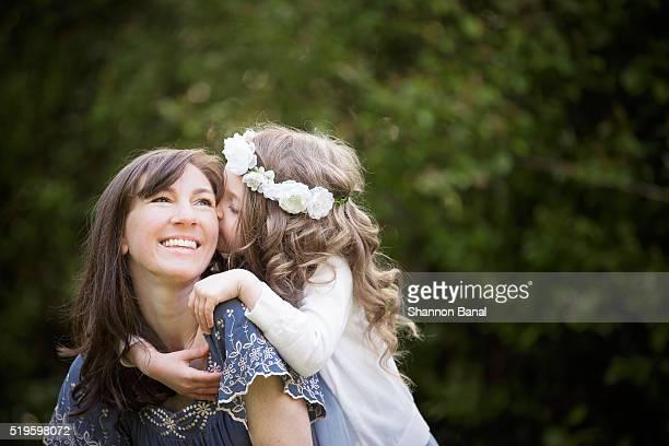 Young Girl Kisses Mom
