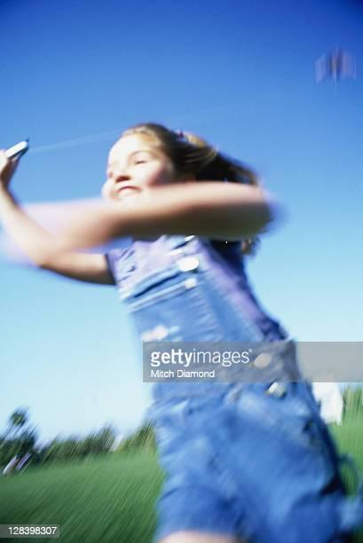 Young girl kite flying