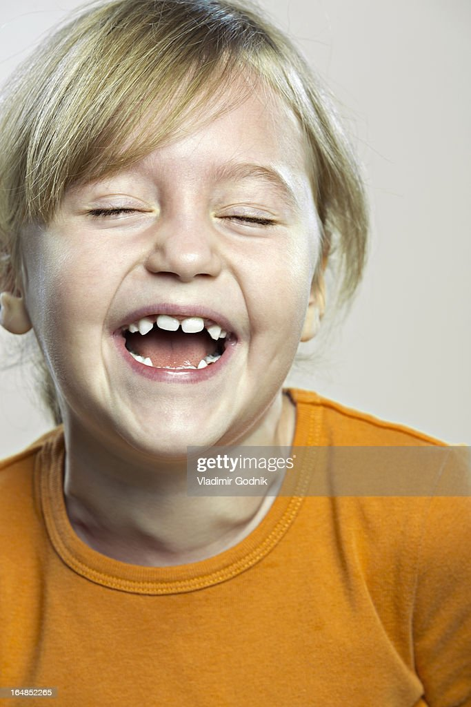 A young girl laughing joyously : Stock Photo