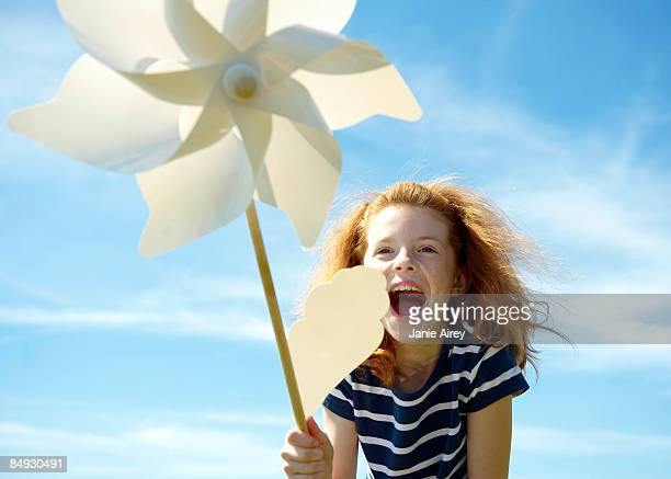 Young girl laughing with windmill