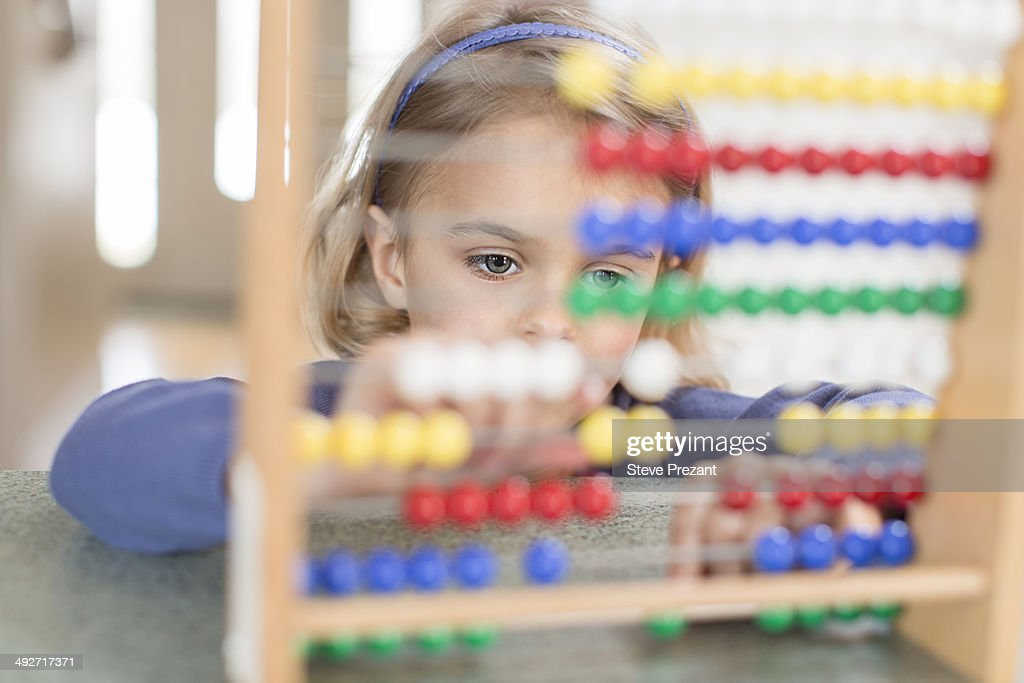 Young girl learning on abacus
