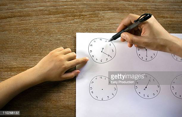 Young girl learning to read the time