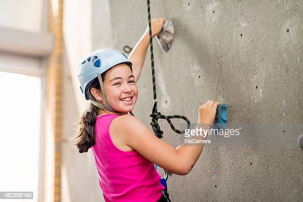 Young Girl Learning to Rock Climb